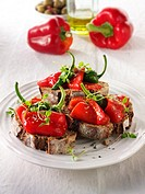 Roast red peppers with padron pepperson toasted rye bread sandwiches - bruschettas