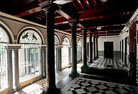 Drawing room, Nattukottai Chettiar house or Nagarathar house at Devakottai in Chettinad , Tamil Nadu  The gleaming black granite pillars are a dominan...