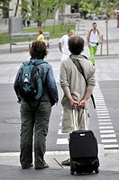 Couple waiting to cross a street, Barcelona, Catalonia, Spain