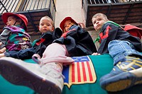 Children riding the`Guita Grossa´ La Patum Masterpiece of Oral and Intangible Heritage by UNESCO Berga  Barcelona  Catalonia  Spain