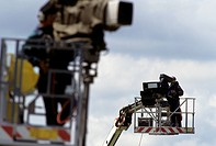 Camera cres on gantries at a sports event