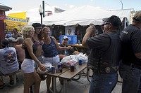 Man taking photo of babes at the 67th Annual Sturgis Motorcycle Rally, Sturgis, South Dakota, August 6_12, 2007