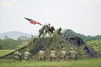 A World War II reenactment of US Marines raising the American flag on Iwo Jima on February 23, 1945 at Mid_Atlantic Air Museum World War II Weekend an...