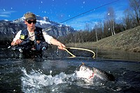 Fly fishing in a mountain lake France