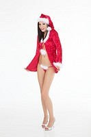 A very beautiful and sexy woman dresses as a sexy santa