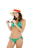 Beautiful and sexy Caucasian waman in a green bikini wearing a hat