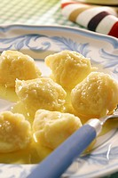 Cheese balls with butter sauce