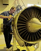 Perry Palhamus, a DynCorp International C-21A aircraft mechanic, dismantles a turbine engine shroud during an engine swap Sept  13, 2010, at Ramstein ...