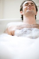 Portrait of young man having a bath