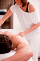 Masseuse preparing to massage a man