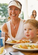 Woman and her daughter eating at a restaurant