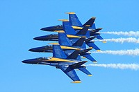 Blue Angels performing maneuvers in McDonnell Douglas now Boeing F/A-18 Hornets at the 2009 Wings Over Houston Airshow, Ellington Field, Houston, Texa...
