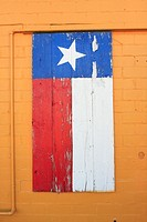 Woden Painted Texas Flag - Bastrop, Texas  On brick wall at Ramos Mexican Restaurant