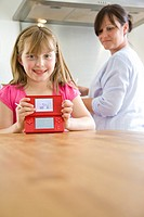 Smiling Girl Holding Video Game