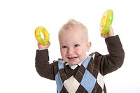Toddler Boy Is Showing To Plastic Yellow Toy Rings
