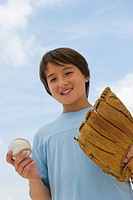 Smiling mixed race boy with baseball and mitt