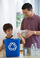 Father and son recycling plastic bottles and tin cans