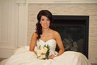 edmonton, alberta, canada, a bride sitting on the floor in front of a fireplace