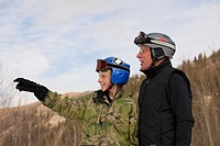 red deer, alberta, canada, a father and son wearing ski masks and helmets at a ski area