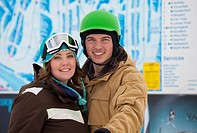 red deer, alberta, canada, a man and woman wearing a helmet and ski mask at a ski area