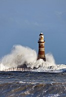 waves crashing against roker lighthouse, sunderland, tyne and wear, england