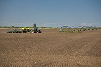 air seeder planting in a tilled field, alberta, canada