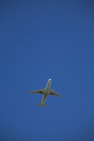 commercial airplane in flight, calgary, alberta, canada