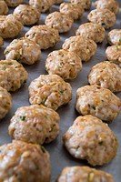 tray of cooked meatballs on a baking sheet