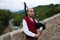 Piper in Roman Bridge. Cangas de Onis. Oriente region. Picos de Europa. Asturias. Spain.