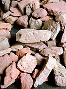 Stone Age ochre fragments. Close_up of a collection of ochre haematite, iron oxide fragments found during excavations at the Blombos cave site in Sout...