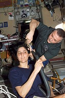 Cutting hair on the International Space Station. Cosmonaut Fyodor N. Yurchikhin, Expedition 15 commander representing Russia´s Federal Space Agency, c...