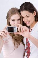 Two young women taking self_portrait