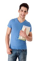 Young man holding books, smiling (thumbnail)