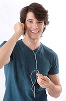 Young man listening to music with earphones happily