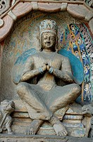 Buddha statue carved inside the ancient Yungang Grottoes, Datong, Shanxi, China.