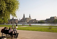 View across the Elbe river towards Theaterplatz the historic center of Dresden, Germany