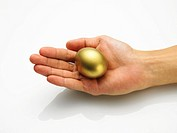 Palm holding a golden egg