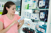 Young woman looking at cosmetics in store
