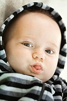 Baby sticking out tongue, portrait (thumbnail)