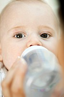 Baby drinking from bottle (thumbnail)