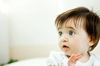 Baby girl with startled expression, portrait