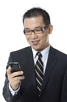 Close_up of a businessman text messaging