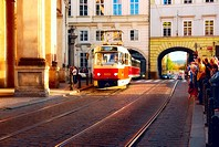 A picture of tram coming to a stop on Prague street  Crowd of people tourists are waiting for a tram in Prague, Czech Republic