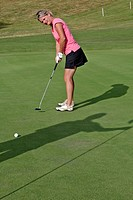 WOMAN GOLFER PUTTING UP TO THE HOLE, GOLF DU PERCHE GOLF COURSE, SOUANCE_AU_PERCHE, EURE_ET_LOIR 28, FRANCE