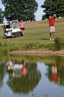 GOLF CART AND GOLFERS IN FRONT OF A POND, GOLF DU PERCHE GOLF COURSE, SOUANCE_AU_PERCHE, EURE_ET_LOIR 28, FRANCE