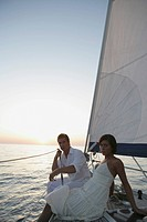Portrait of a young couple relaxing on a sailboat