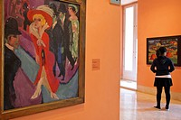 PAINTING BY ERNST LUDWIG KIRCHNER AND A YOUNG WOMAN IN ONE OF THE 18 EXHIBITION HALLS, THYSSEN_BORNEMISZA MUSEUM MUSEO OF FINE ARTS, MADRID, SPAIN