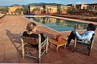 JEAN_MARTIN HERBECQ, FOUNDER AND DIRECTOR OF TERRES D´AMANAR, WITH A FRIEND BY THE POOL, ECO_LODGES IN THE TERRES D´AMANAR NATURE PARK, TAHANAOUTE, AL...