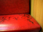 Tramway seat with graffiti