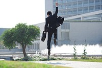 A businessman jumping